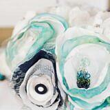 Peacock earrings on handmade fabric bouquet